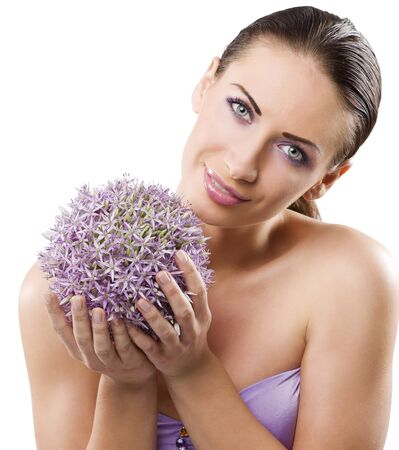 beauty portrait of a graceful brunette with a bouquet of little purple flower isolated on white photo