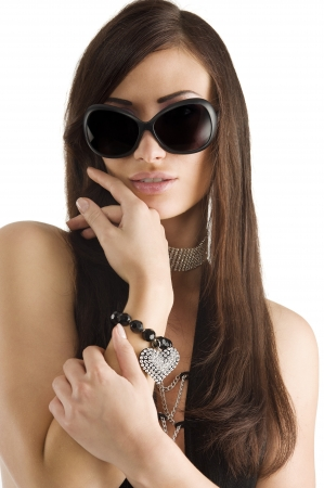 costume jewelry: closeup portrait of pretty brunette with long dark hair sunglasses and jewellery Stock Photo