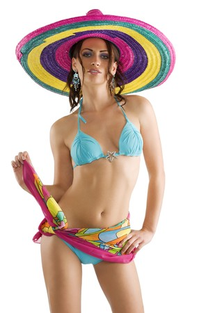 summer portrait of a cute girl wearing a bikini colored scarf and a big colorful hat like a sombrero photo