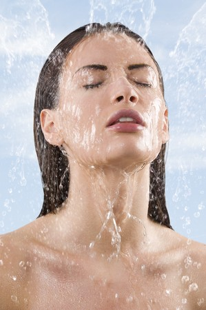 close up portrait of a pretty young woman getting some fresh water on her face falling down Stock Photo - 7378689