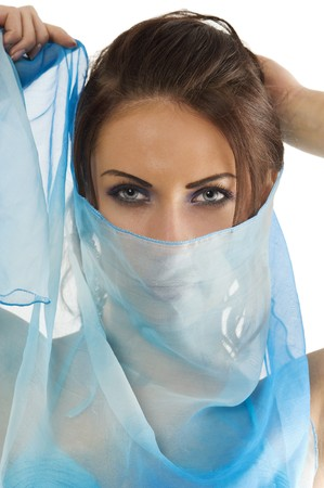 close up portrairt of a pretty brunette with blue-sky headscarf playing to hide her face   photo