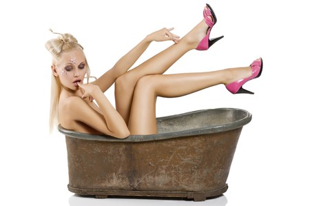 nude blonde woman: fashions shot of sexy blond girl pin up with a nice creative make up and hair styling in an old little bath Stock Photo