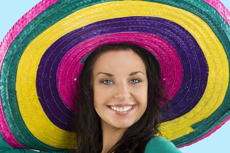 sombrero: close up portrait of a beautiful smiling woman with e big colored hat like a sombrero