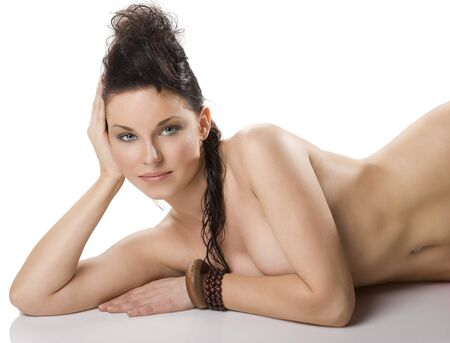 beauty portrait of the beautiful young naked woman with beauty and creative hair style lying on the floor and ethnic accessory Stock Photo - 7514305