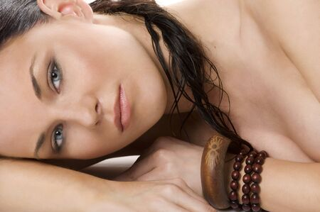 close up porrait of beauty brunette woman with ethnic accessory looking in camera photo