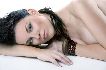 beauty shot of a young brunette laying down and looking in camera with her stunning blue eyes Stock Photo - 7514308