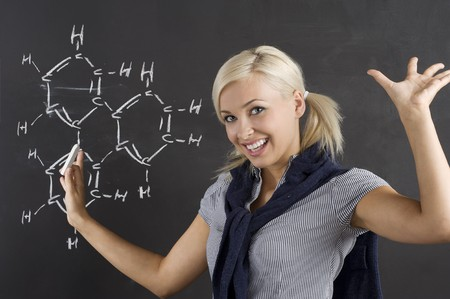 student enjoing for her chemical lesson in front of blackboard Stock Photo - 7598062