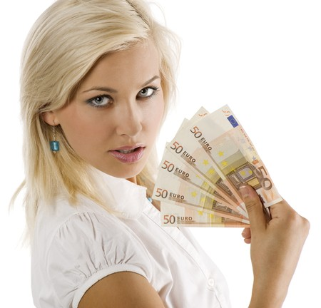 european money: cheerful young blond lady holding euro cash and smiling Stock Photo