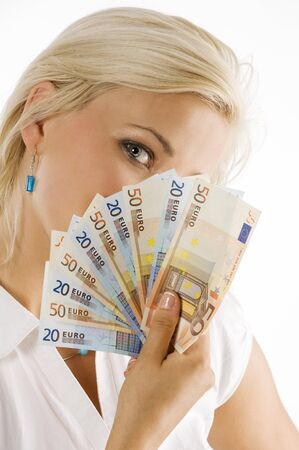 blond girl hiding her face behind an euro money fan Stock Photo - 7635472