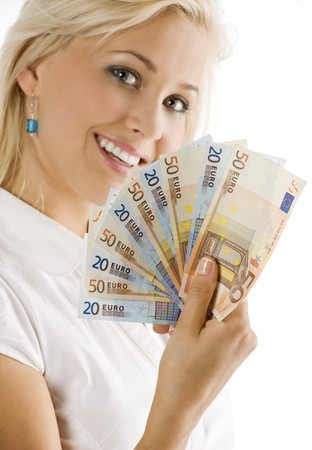 smiling girl keeping a fan of euro cash . FOCUS ON THE MONEY . FACE NOT IN FOCUS Stock Photo - 7635471