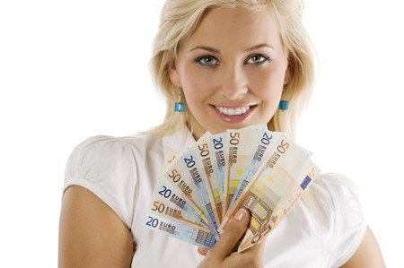 cute blond girl smiling behind a fun of euro money. FACE NOT IN FOCUS . FOCUS ON THE MONEY . Stock Photo - 7635441