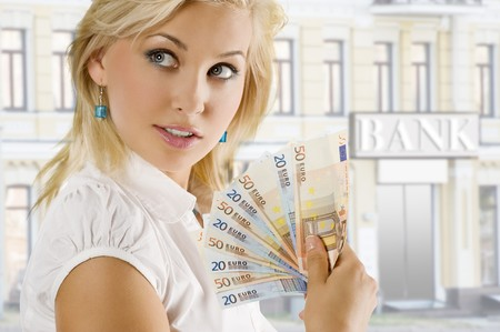 cheerful young blond lady holding euro cash and smiling photo