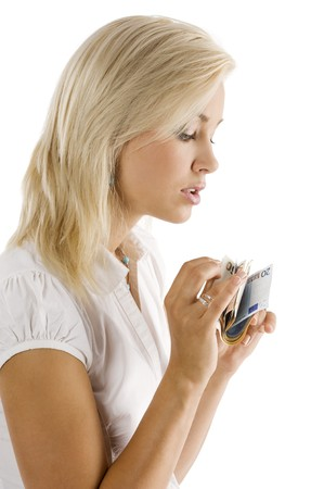 beautiful blond girl in act to count some euro cash from her hands Stock Photo - 7635470