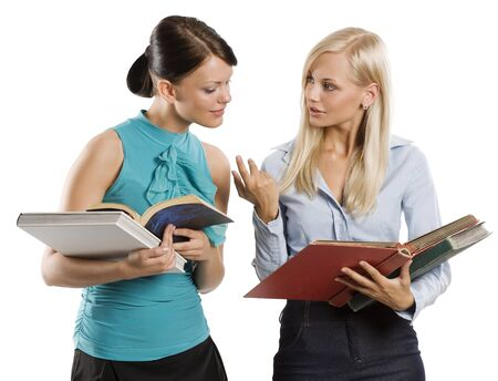 two female girl student in nice dress carrying book and chatting each others Stock Photo - 7635514