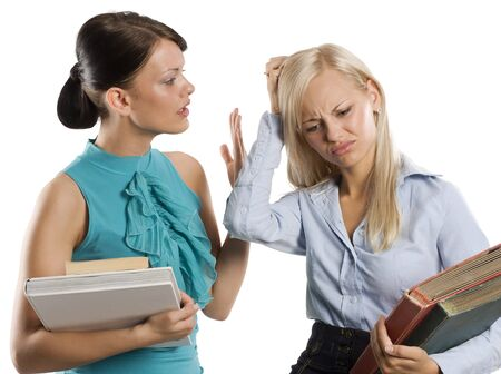 two student girl talking . one looking worried for something maybe exam. Stock Photo - 7635515
