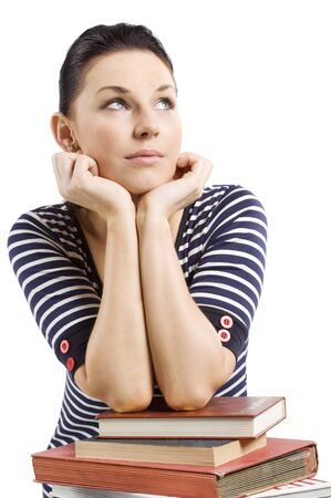 nice girl: nice girl student in act to think with her arm over some books Stock Photo