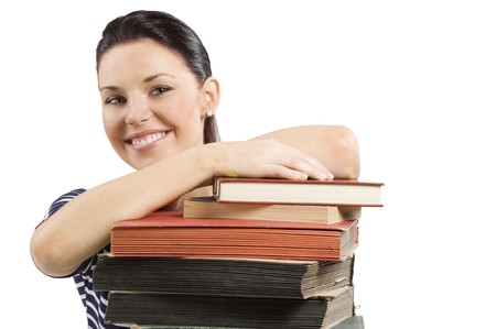 close up portrait of smiling cute girlstaying over a pile of old books photo