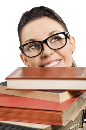 coming up with: pretty student with big glasses coming up with hr face from a pile of book Stock Photo