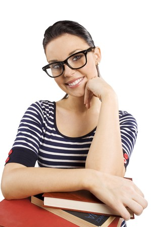 pretty and young student with big funny glasses near some books smiling in camera photo