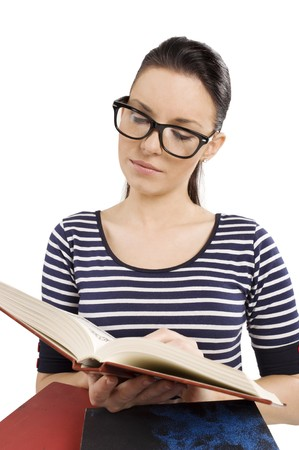 young and graceful girl reading a book and wearing big glasses photo