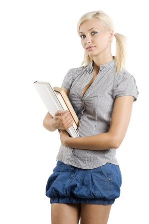 graceful young girl student in casual dress keeping some books in arm and looking in camera photo