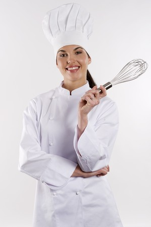 female chef: young graceful woman dressed as a cook with cap over white backgound