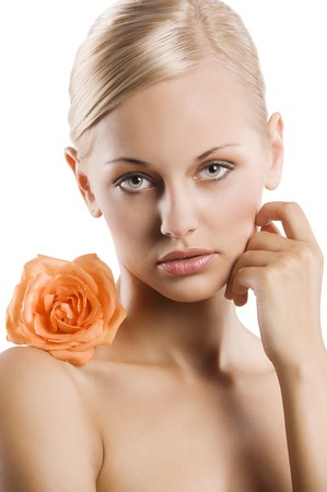 beauty portrait af sweet and nice blond girl with an orange rose on her shoulder photo