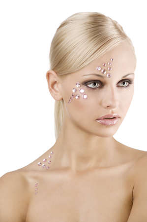 faceart: blond young girl in a beauty portrait with creative make up and pink crystal stone on her face