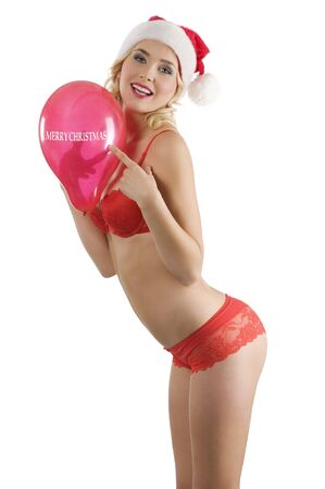 sexy blond santa claus in red lingerie with a red balloon looking in camera and smiling Stock Photo - 8191936