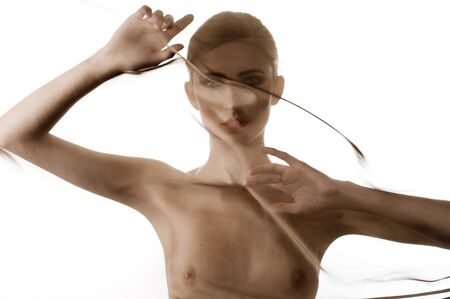 art fashion portrait of naked woman behind transparent material showing her breast Stock Photo - 8340102