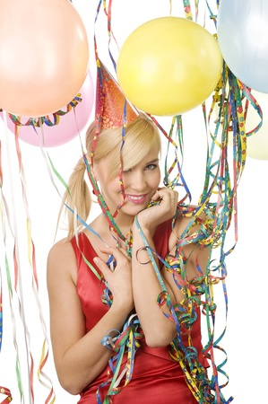 Pretty blond woman in red dress with balloons and colored ribbons during a party over white smiling Stock Photo - 8432715