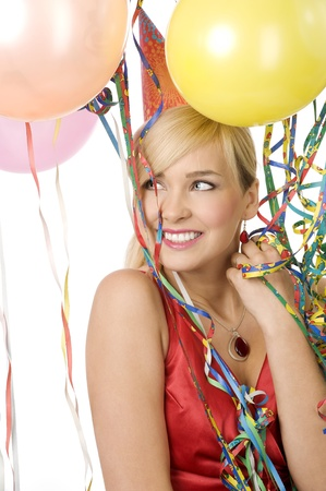 Pretty blond woman in red dress with balloons during a party over white smiling Stock Photo - 8432711