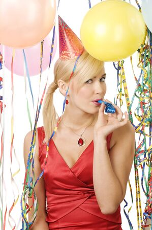 portrait of blond young woman in red dress enjoying a party between colored balloons photo