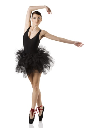 classic dancer with black dress and shoes on white background dancing on pointe photo
