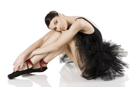 very beautiful ballerina in black tutu sitting and laying an white like a swan Stock Photo - 8483814