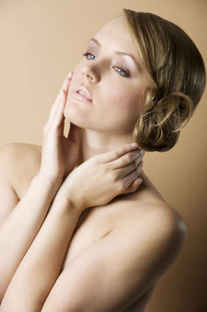very nice blond girl naked with natural make up and an old fashion hair style photo