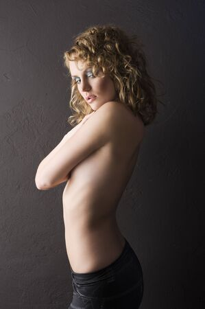 sexy young woman with naked shoulder and curly hair on black background Stock Photo - 8753522