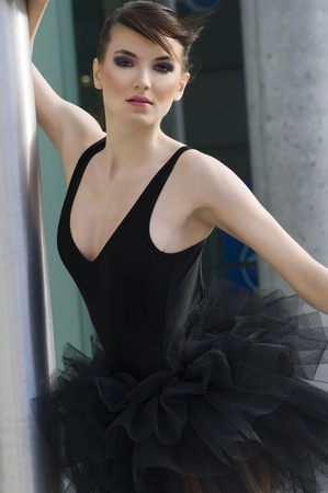 black swan: nice portrait of a beautiful young woman dancer outdoor with black tutu Stock Photo