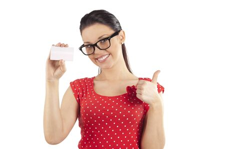 card making: woman with glasses showing a busines card and making a positive sign