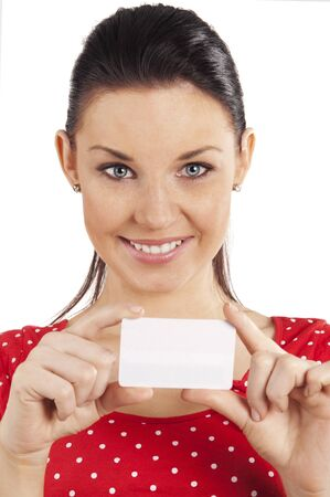Portrait of happy young woman in red dress with bussiness card against white background photo