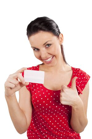 Portrait of happy positive young woman in red dress with bussiness card against white background Stock Photo - 8886637