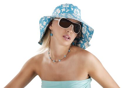 Portrait of young pretty woman in summer contest with hat and sunglasses   photo