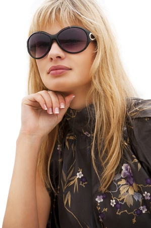 young blond beautiful woman in elegant dress wearing sunglasses over white photo
