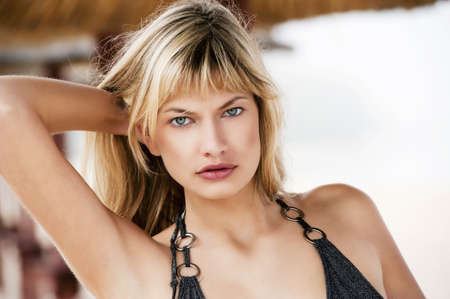 sensual portrait of blond girl outdoor with bikini swimsuit photo