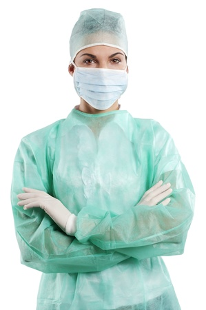 pretty nurse wearing a surgery dress with cap mask and gloves isolated over white Stock Photo - 9703099