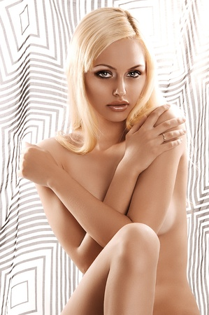 glamour portrait of a pretty blonde girl covering her nude body with her arms Stock Photo - 10232108
