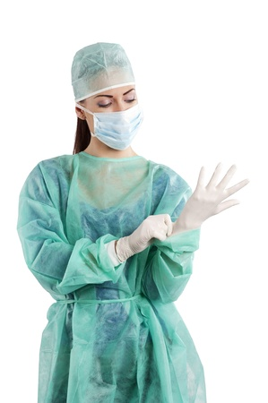 nice woman in green surgery dress with cap mask and gloves  Stock Photo - 10422345