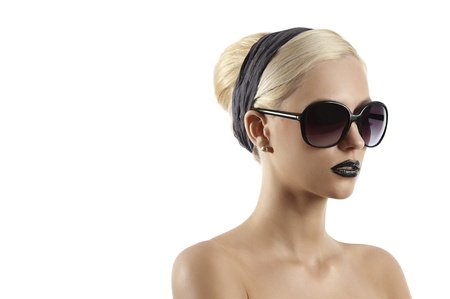 fashion portrait of young blond woman with hair style black lips and wearing sunglasses against white background photo