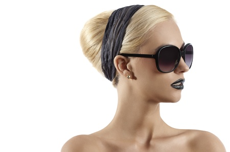 fashion portrait of young blond woman with hair style black lips and wearing sunglasses against white background Stock Photo - 10441788