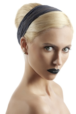 fashion portrait of young blond woman with hair style black lips looking at the camera against white background photo